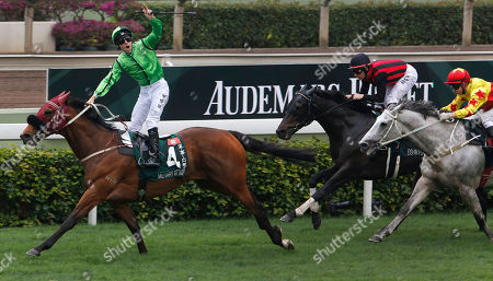 Tommy Berry, Matthew Chadwick, Mirco Demuro Australian jockey Tommy Berry riding Hong Kong horse Military Attack, left, celebrates as he wins the 2,000-meter Audemars Piguet QE II Cup at the Shatin race track in Hong Kong . At right is Hong Kong jockey Matthew Chadwick riding Hong Kong horse California Memory finished second. Second from right is Italian jockey Mirco Demuro riding Japanese horse Elshin Flash finished third