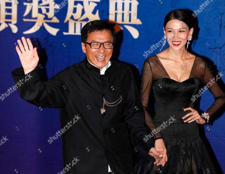 Jackie Chan, Zhang Lanxin Hong Kong movie star Jackie Chan, left, and Chinese actress Zhang Lanxin pose at the red carpet for the Huading Awards in Hong Kong