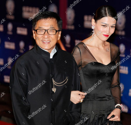 Stock Picture of Jackie Chan, Zhang Lanxin Hong Kong movie star Jackie Chan, left, and Chinese actress Zhang Lanxin pose at the red carpet for the Huading Awards in Hong Kong