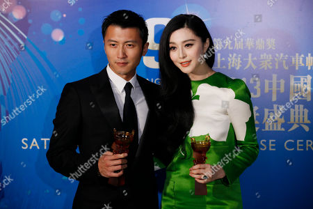 Fan Bingbing, Nicholas Tse Hong Kong actor Nicholas Tse, left and Chinese actress Fan Bingbing pose after winning the Best Actor and the Best Actress in China Awards of the Huading Awards in Hong Kong