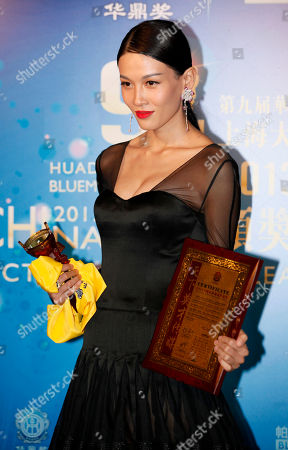 Stock Picture of Zhang Lanxin Chinese actress Zhang Lanxin poses after winning the Best Newcomer in China Award at the Huading Awards in Hong Kong