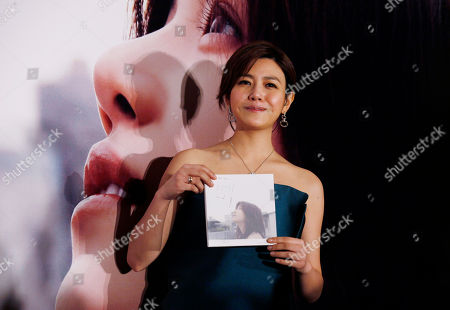 """Michelle Chen Taiwanese singer-actress Michelle Chen poses with her new song album """"Me, Myself and I"""" during a promotional event in Hong Kong"""