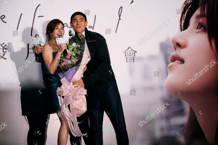 "Michelle Chen, Eddie Peng Yu-yen Taiwanese singer-actress Michelle Chen, left, poses with Taiwanese actor Eddie Peng Yu-yen during a promotional event for her new song album ""Me, Myself and I"" in Hong Kong"