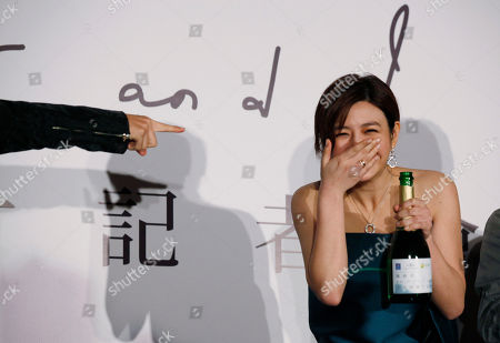 """Michelle Chen Taiwanese singer-actress Michelle Chen laughs during a promotional event for her new song album """"Me, Myself and I"""" in Hong Kong"""