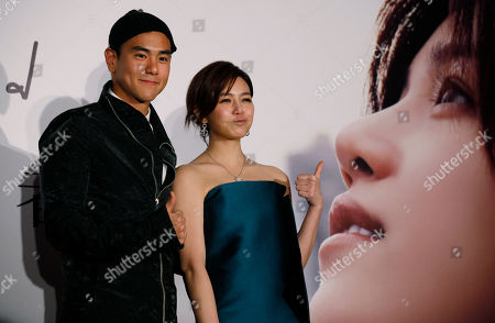 "Michelle Chen, Eddie Peng Yu-yen Taiwanese singer-actress Michelle Chen poses with Taiwanese actor Eddie Peng Yu-yen during a promotional event for her new song album ""Me, Myself and I"" in Hong Kong"