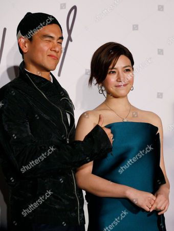 "Michelle Chen, Eddie Peng Yu-yen Taiwanese singer-actress Michelle Chen poses with Taiwanese actor Eddie Peng Yu-yen for photographers during a promotional event for her new song album ""Me, Myself and I"" in Hong Kong"