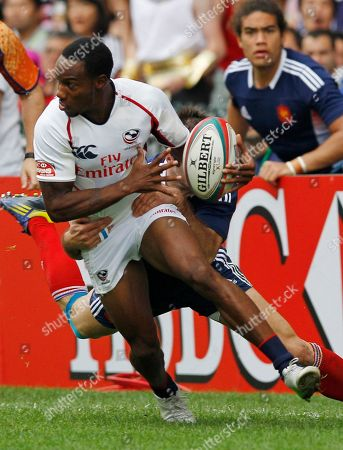 Carlin Isles, Renaud Delmas Carlin Isles of the U.S. front, is tackled by Renaud Delmas of France, back, during the day 2 match of the Hong Kong Sevens rugby tournament in Hong Kong