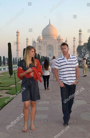 Stock Photo of Brett Lee Former Australian cricketer Brett Lee and former Miss Australia Jesinta Campbell walk in front of the Taj Mahal in Agra, India, . The two are in the country to shoot for a documentary