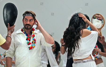 """Neil Nitin Mukesh, Puja Gupta Graph, Indian Bollywood actors Neil Nitin Mukesh, left, and Puja Gupta, back to camera check their make up while shooting their upcoming film """"Shortcut Romeo"""" in Mumbai, India. Friday, May 3 marks exactly a hundred years after India's first feature film """"Raja Harischandra,"""" a silent movie, was screened in 1913. India produced almost 1,500 movies last year and the industry is expected to grow from $2 billion to $3.6 billion in the next five years, according to consultancy KPMG"""