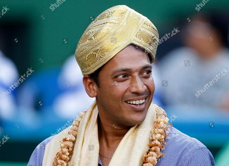 Mahesh Bhupathi Indian tennis player Mahesh Bhupathi smiles after he was presented a traditional head-gear during a felicitation ceremony before the Group I Asia-Oceania Relegation Play-off tennis doubles match at the Davis Cup between India and Indonesia, in Bangalore, India