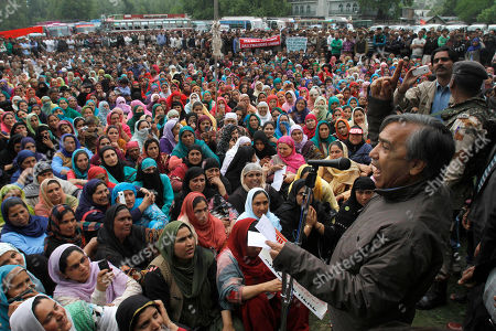 Mohammad Yousuf Tarigam, leader of Communist Party of India (Marxist), speaks to supporters during a protest to mark May Day in Srinagar India, . May Day moved beyond its roots as an international workers' holiday to a day of international protest Wednesday, with rallies throughout Asia demanding wage increases and sounding complaints about being squeezed by big business amid the surging cost of living