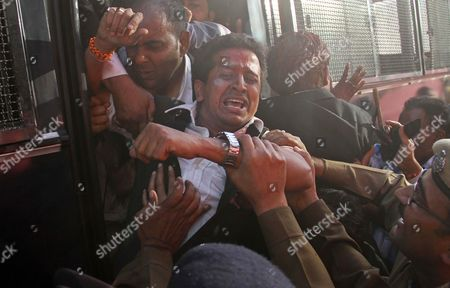 An Indian lawyer shouts slogans as he is detained during a protest against the visit of Pakistani Prime Minister Raja Pervaiz Ashraf in Ajmer, India, . Ashraf is in India on a daylong private trip to visit the shrine of Khwaja Moinuddin Chishti in Ajmer. Sufism is a more mystical form of Islam that is practiced in many parts of South Asia