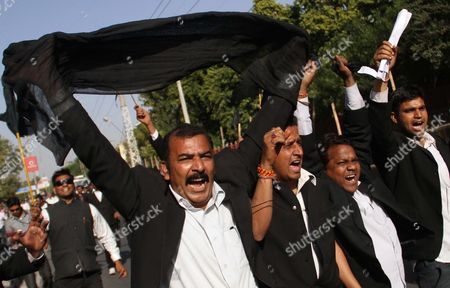 Indian lawyers shout slogans during a protest against the visit of Pakistani Prime Minister Raja Pervaiz Ashraf in Ajmer, India, . Ashraf is in India on a daylong private trip to visit the shrine of Khwaja Moinuddin Chishti in Ajmer. Sufism is a more mystical form of Islam that is practiced in many parts of South Asia
