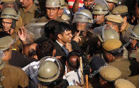 Indian lawyers tussle with policemen during a protest against the visit of Pakistani Prime Minister Raja Pervaiz Ashraf in Ajmer, India, . Ashraf is in India on a daylong private to visit the shrine of Khwaja Moinuddin Chishti in Ajmer. Sufism is a more mystical form of Islam that is practiced in many parts of South Asia