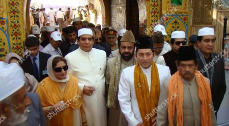 Raja Pervaiz Ashraf Pakistani Prime Minister Raja Pervaiz Ashraf, center left in cream, and his wife Nusrat Pervaiz Ashraf visit the shrine of Khwaja Moinuddin Chishti in Ajmer, India, . Ashraf is in India on a daylong private visit to the Muslim shrine. Sufism is a more mystical form of Islam that is practiced in many parts of South Asia