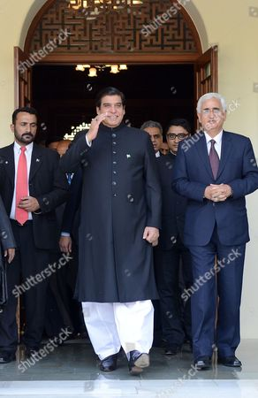 Salman Khurshid, Raja Pervaiz Ashraf Pakistan's Prime Minister Raja Pervaiz Ashraf gestures as he walks with Indian Foreign Minister Salman Khurshid, right, in Jaipur, India, . Ashraf is in India on Saturday on a daylong private visit to the shrine of Sufi saint Khwaja Moinuddin Chishti in the nearby town of Ajmer. Sufism is a more mystical form of Islam that is practiced in many parts of South Asia