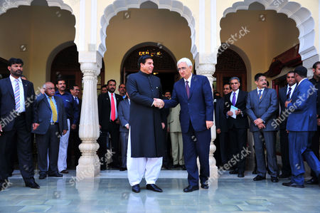 Salman Khurshid, Raja Pervaiz Ashraf Indian Foreign Minister Salman Khurshid, right, shakes hands with Pakistan's Prime Minister Raja Pervaiz Ashraf in Jaipur, India, . Ashraf is in India on Saturday on a daylong private visit to the shrine of Sufi saint Moinuddin Chishti in the nearby town of Ajmer. Sufism is a more mystical form of Islam that is practiced in many parts of South Asia