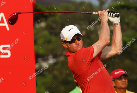 Simon Dyson Simon Dyson of Britain watches his tee during the first round of Indonesian Masters golf tournament in Jakarta, Indonesia