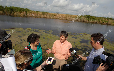 Sally Jewell Secretary of the Interior Sally Jewell talks to reporters after touring the Loxahatchee National Wildlife Refuge in Palm Beach County, Fla., . Jewell took over the department from Ken Salazar earlier this month. Her stop Wednesday in South Florida is one of her first official trips and highlights the importance of Everglades restoration to the agency responsible for national parks and other public lands