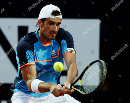 Potito Starace Italy's Potito Starace returns the ball to Switzerland's Roger Federer during their match at the Italian Open tennis tournament in Rome