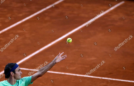 Roger Federer Switzerland's Roger Federer serves the ball to Italy's Potito Starace during their match at the Italian Open tennis tournament in Rome