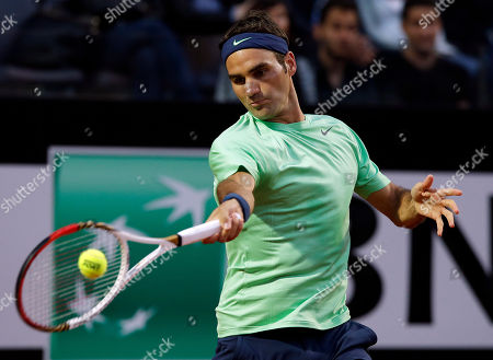 Roger Federer Switzerland's Roger Federer returns the ball to Italy's Potito Starace during their match at the Italian Open tennis tournament in Rome
