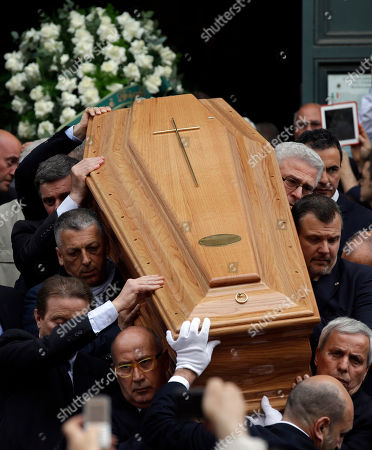 The Coffin of late Italian Senator Giulio Andreotti is carried outside the San Giovanni dei Fiorentini, St John of the Florentines, church at the end of the funeral service in Rome, . Giulio Andreotti, Italy's former seven-time premier, has died at age 94 Monday. At his prime, Andreotti was one of Italy's most powerful men: he helped draft the country's constitution after World War II, sat in parliament for 60 years and served as premier seven times
