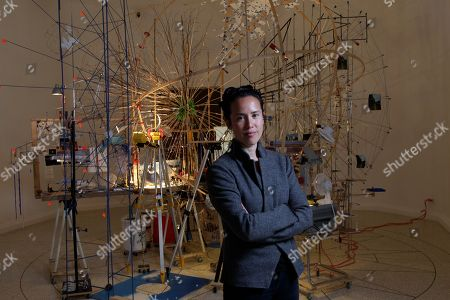 Sarah Sze Artist Sarah Sze poses in front of the installation 'Planetarium' part of her project 'Triple point' on display at the U.S. Pavilion, during a press preview of the 55th edition of the Venice Biennale of Arts in Venice, northern Italy