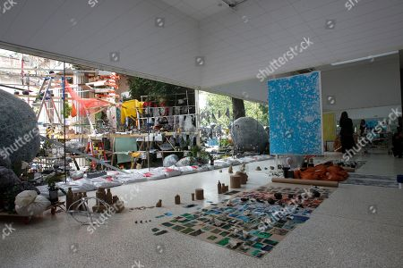 Visitors look at the project 'Triple point' by artist Sarah Sze at the U.S. Pavilion during a press preview of the 55th edition of the Venice Biennale of Arts in Venice, northern Italy