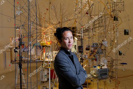 Sarah Sze On, artist Sarah Sze poses in front of the installation 'Planetarium' part of her project 'Triple point' on display at the U.S. Pavilion, during a press preview of the 55th edition of the Venice Biennale of Arts in Venice, northern Italy