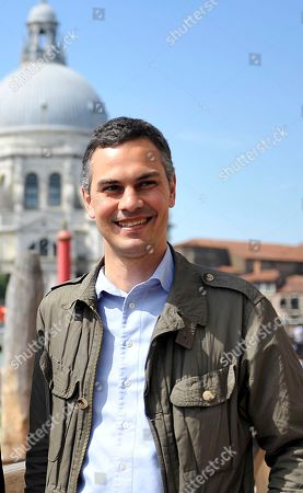 """On, Biennale curator Massimiliano Gioni poses for photos in Venice, Italy. Massimiliano Gioni is the youngest curator ever at the world's oldest contemporary art fair - the Venice Biennale. Yet it is not so much his relative youth, at age 39, that gives him an edge as he presents the main show of the prestigious event that can make or break the careers of the artists who are exhibited, but his experience. """"I wanted to make a show that is open to people who are not expected to be in the Biennale. If with youth comes innovation, I am happy,"""" Gioni said in an interview. """"Youth for the sake of youth is always a way to brand products"""