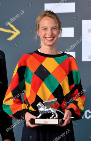 French artist Camille Henrot holds her Silver Lion award for best promising young artist at the 55th Venice Biennale of Art prize-giving ceremony, in Venice, Italy