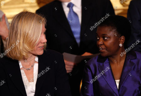 Josefa Idem, Cecile Kyenge Olympic gold medal kayaker, Equal Opportunities, Sport and Youth Policies Minister Josefa Idem, left, talks to Integration Minister Cecile Kyenge, of Congolese origin, during the swearing in ceremony of the new government at the Quirinale presidential palace in Rome, . Two Italian paramilitary police officers were shot and wounded Sunday in a crowded square outside the premier's office in Rome as Italy's new leader Enrico Letta and his Cabinet were being sworn in a kilometer (half-mile) away. It was unclear if there was any connection between the events