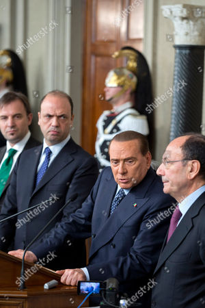People for Freedom, PDL, party leader Silvio Berlusconi, second from right, is flanked by senator Renato Schifani, right, Northern League lawmaker Massimo Bitonci, left, and PDL secretary Angelino Alfano, second from left, as he gives his statement in front of a courassier presidential guard after talks with Italian President Giorgio Napolitano on the formation of a new government, in Rome's Quirinale presidential palace, . Fresh elections could soon be called if President Napolitano, after consultations on Wednesday and Thursday, decides no one can muster a reliable enough majority in Parliament to enact the economic and electoral reforms needed to pull Italy out of recession and improve future prospects for stable governments