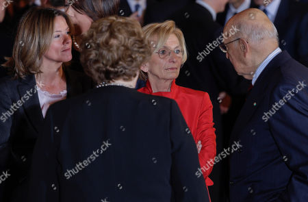 From left, Health Minister Beatrice Lorenzin, ustice Minister Anna Maria Cancellieri and Foreign Minister Emma Bonino look at President Giorgio Napolitano during the swearing in ceremony of the new government at the Quirinale Presidential Palace, in Rome