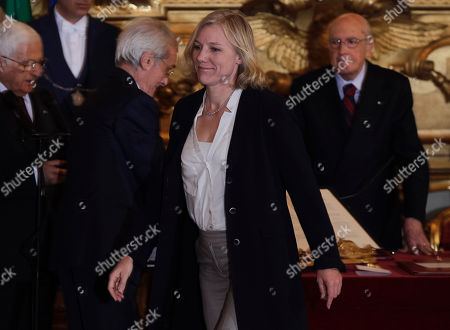 Josefa Idem Olympic gold medal kayaker, Equal Opportunities, Sport and Youth Policies Minister Josefa Idem walks past Italian President Giorgio Napolitano, right, moments after taking oath during the swearing in ceremony of the new government at the Quirinale Presidential Palace, in Rome, . Two Italian paramilitary police officers were shot and wounded Sunday in a crowded square outside the premier's office in Rome as Italy's new leader Letta and his Cabinet were being sworn in a kilometer (half-mile) away. It was unclear if there was any connection between the events