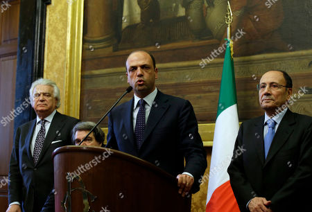 From left, People of Freedom party Denis Verdini, Renato Brunetta, Angelino Alfano and Renato Schifani talk to journalists after meeting with premier-designate Enrico Letta in Rome, . The center-left leader picked by Italy's president to form a coalition government worked doggedly Thursday to find common ground among bitterly opposed political blocs, which have been mired in deadlock for months