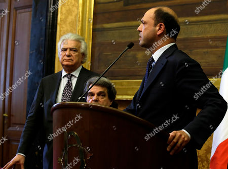 From left, People of Freedom party Denis Verdini, Renato Brunetta, Angelino Alfano talk to journalists after meeting with premier-designate Enrico Letta in Rome, . The center-left leader picked by Italy's president to form a coalition government worked doggedly Thursday to find common ground among bitterly opposed political blocs, which have been mired in deadlock for months