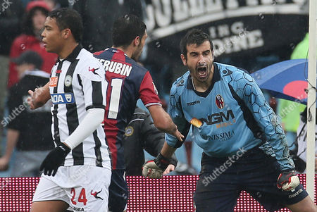 Bologna's goalkeeper Gianluca Curci, react after saving on a penalty from Antonio Di Natale, during the Serie A soccer match between Udinese and Bologna, at the Friuli Stadium in Udine, Italy