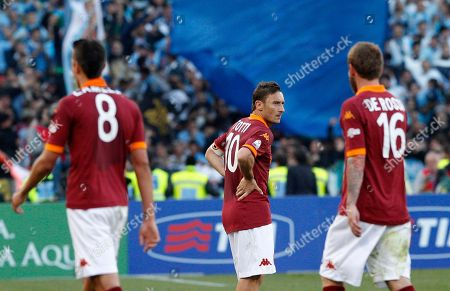 From left, AS Roma forwards Erik Lamela, of Argentina, Francesco Totti and midfielder Daniele De Rossi react at the end of the Italian Cup, final soccer match between AS Roma and Lazio, at Rome's Olympic stadium, . Lazio took city bragging rights by beating Roma 1-0 Sunday in a derby to win a heated Italian Cup final and maintain its recent edge in the series. Bosnia-Herzegovina midfielder Senad Lulic scored in the 71st minute at the Stadio Olimpico after Roma goalkeeper Bogdan Lobont failed to clear a cross from Antonio Candreva, leaving Lulic to put the ball in uncontested by the far post