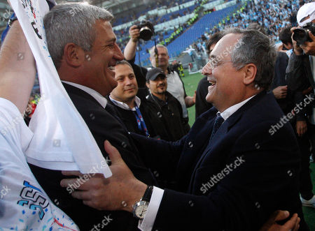Lazio coach Vladimir Petkovic, of Bosnia, is congratulated by president Claudio Lotito, right, after the Italian Cup, final soccer match between AS Roma and Lazio, at Rome's Olympic stadium, . Lazio took city bragging rights by beating Roma 1-0 Sunday in a derby to win a heated Italian Cup final and maintain its recent edge in the series. Bosnia-Herzegovina midfielder Senad Lulic scored in the 71st minute at the Stadio Olimpico after Roma goalkeeper Bogdan Lobont failed to clear a cross from Antonio Candreva, leaving Lulic to put the ball in uncontested by the far post