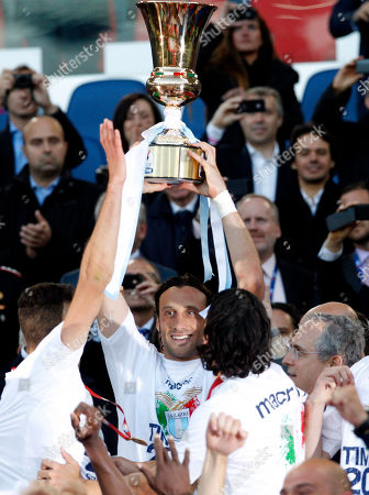 Stefano Mauri Lazio captain Stefano Mauri holds up the trophy at the end of the Italian Cup final soccer match between AS Roma and Lazio, at Rome's Olympic stadium, Lazio took city bragging rights by beating Roma 1-0 Sunday in a derby to win a heated Italian Cup final and maintain its recent edge in the series. Bosnia-Herzegovina midfielder Senad Lulic scored in the 71st minute at the Stadio Olimpico after Roma goalkeeper Bogdan Lobont failed to clear a cross from Antonio Candreva, leaving Lulic to put the ball in uncontested by the far post