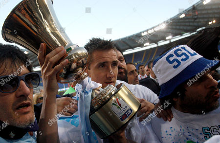 Miroslav Klose Lazio forward Miroslav Klose, of Germany, holds the trophy at the end of the Italian Cup final soccer match between AS Roma and Lazio, at Rome's Olympic stadium, . Lazio took city bragging rights by beating Roma 1-0 Sunday in a derby to win a heated Italian Cup final and maintain its recent edge in the series. Bosnia-Herzegovina midfielder Senad Lulic scored in the 71st minute at the Stadio Olimpico after Roma goalkeeper Bogdan Lobont failed to clear a cross from Antonio Candreva, leaving Lulic to put the ball in uncontested by the far post