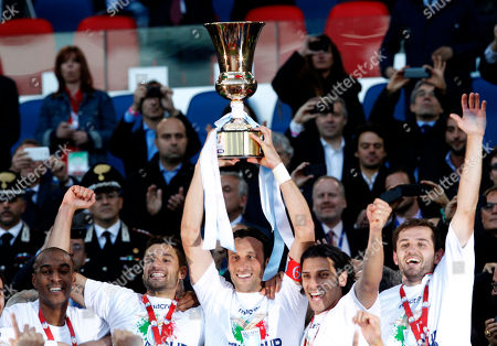 Lazio captain Stefano Mauri holds up the trophy at the end of the Italian Cup final soccer match between AS Roma and Lazio, at Rome's Olympic stadium, Lazio took city bragging rights by beating Roma 1-0 Sunday in a derby to win a heated Italian Cup final and maintain its recent edge in the series. Bosnia-Herzegovina midfielder Senad Lulic scored in the 71st minute at the Stadio Olimpico after Roma goalkeeper Bogdan Lobont failed to clear a cross from Antonio Candreva, leaving Lulic to put the ball in uncontested by the far post