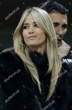Italian actress Elena Santarelli and her partner Bernardo Corradi attend a Serie A soccer match between AC Milan and Lazio, at the San Siro stadium in Milan, Italy
