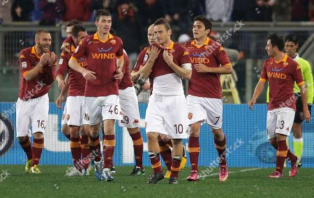 AS Roma Simone Perrotta, third from left, is celebrated by his teammates after he scored during a Serie A soccer match between As Roma and Genoa, in Rome's Olympic stadium