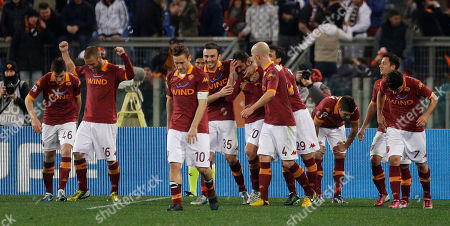 AS Roma Simone Perrotta, center, is celebrated by his teammates after he scored during a Serie A soccer match between As Roma and Genoa, in Rome's Olympic stadium
