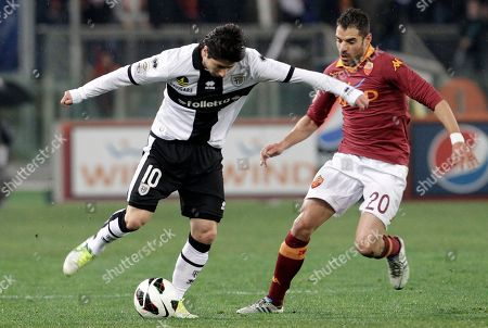Jaime Andres Valdes Simone Perrotta Parma midfielder Jaime Andres Valdes, of Chile, is challenged by AS Roma midfielder Simone Perrotta during a Serie A soccer match between AS Roma and Parma, at Rome's Olympic stadium