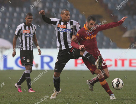 Roma's Simone Perrotta, right, and Udinese's Gabriel Silva challenge for the ball during the Serie A soccer match between Udinese and Roma, at the Friuli Stadium in Udine, Italy