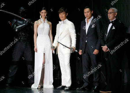 """Lee Byung-hun, Jon M. Chu, Nanao, Jo Shishido South Korean actor Lee Byung-hun, second from left, and director Jon M. Chu, second from right, pose for photographers with Japanese actress Nanao, left, and actor Jo Shishido during the Japan premiere of their latest film """"GI Joe 3D Retaliation"""" in Tokyo"""